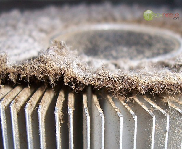 Computer heatsink blocked by cigarette tar and dust: Closeup